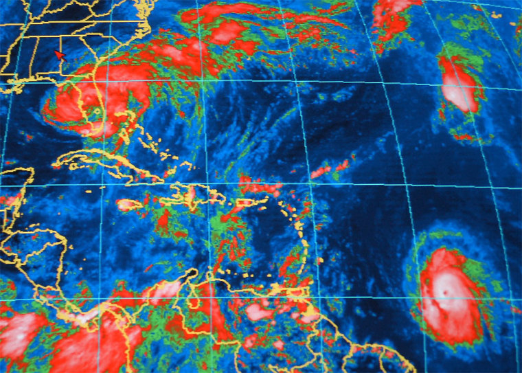 An infrared satellite image from the National Oceanic and Atmospheric Administration shows Hurricane Frances at upper left over Florida on Sunday, with Hurricane Ivan at lower right, about 800 miles east-southeast of Barbados.