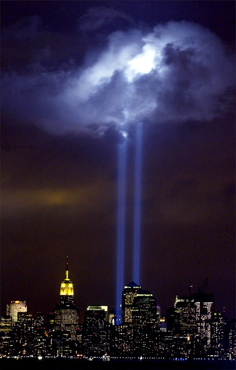 A test of the Tribute in Light memorial illuminates a passing cloud above lower Manhattan Thursday, Sept. 9, 2004.