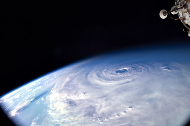 Thisview of Hurricane Ivan was taken from aboard the international space station, a part of which can be seen at top right.