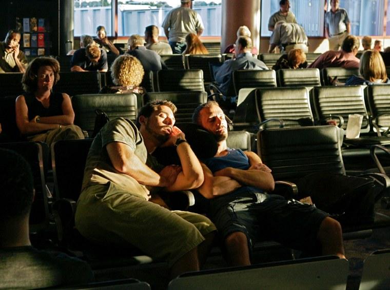 Passengers wait through flight delays Tuesday at McCarran Airport in Las Vegas.