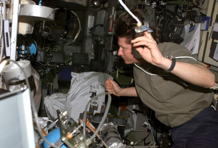 In a photo from Sept. 8, Russian cosmonaut Gennady Padalka performs maintenance on a spare version of a part connected to the Russian Elektron oxygen-generation system on the international space station.