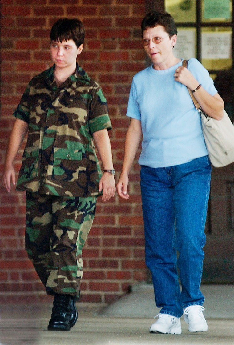 Pfc. Lynndie England, left,and her mother, Terrie England, leave an administrative hearing at Fort Bragg, N.C., in an Aug. 31 file photo.