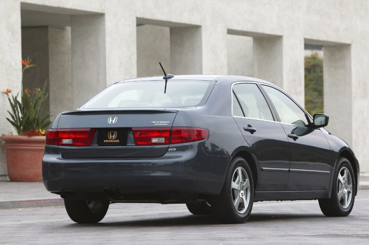 """The 2005 Honda Accord Hybrid doesn't look much different than its gas-only sibling, but one clear identifier is a """"Hybrid"""" badge below the Accord stamp on the trunk."""