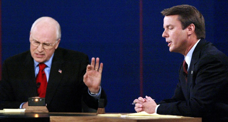 Vice President Cheney listens to Senator Edwards during their vice presidential debate