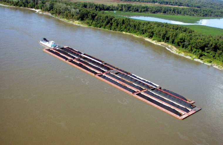 Barge shipments on the Mississippi River, like this one near Vicksburg, Miss., are longer than most existing locks can accommodate, requiring crews to decouple the barges in order to fit them in.