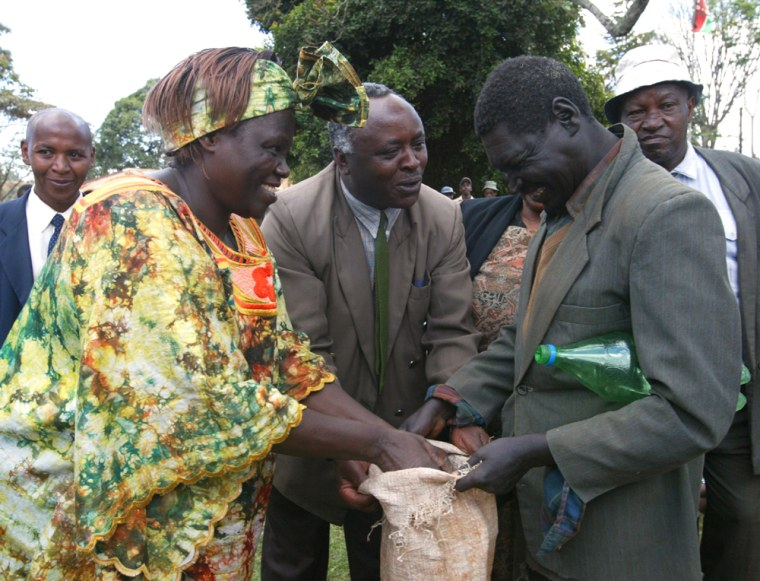 Celebrating her Nobel Peace Prize, Wangari Maathai on Friday reached out tovillagers in Ihururu, Kenya, where she helped distribute farm aid while talking about the importance of preserving forests.