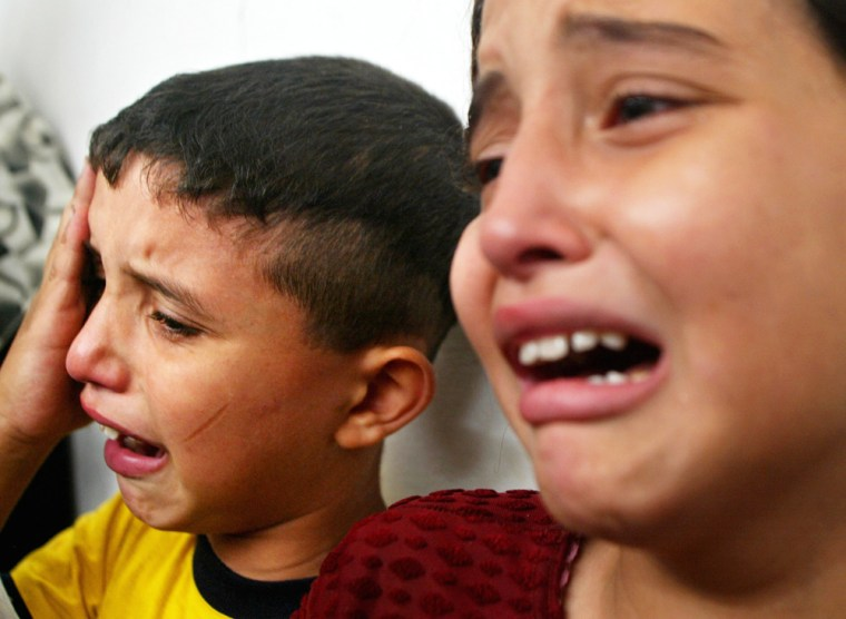 The children of Palestinian school teacher Maher Zagoot weep during his funeral in the Jebaliya refugee camp in the northern Gaza Strip on Sunday. Zagoot was killed in an Israeli missile strike earlier in the day.