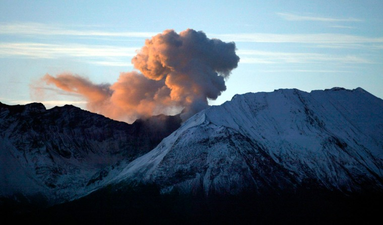 Early morning sun light filters through steam released by Mount St. Helens Monday.