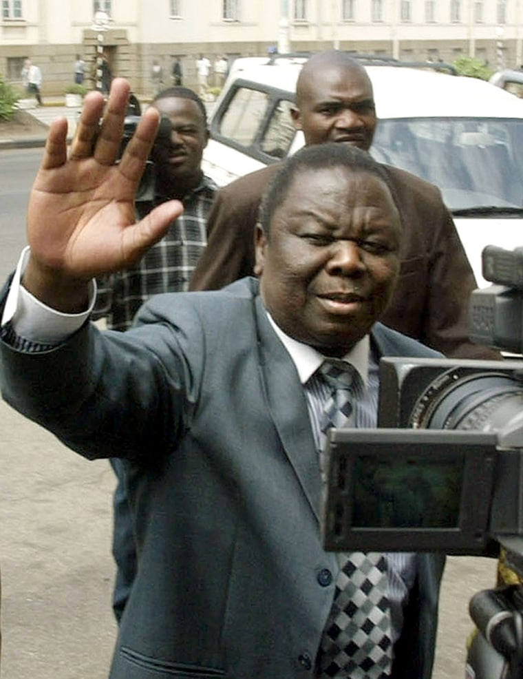 Zimbabwe's Movement For Democratic Change leader Morgan Tsvangirai enters the High Court for his treason trial in Harare on Friday.