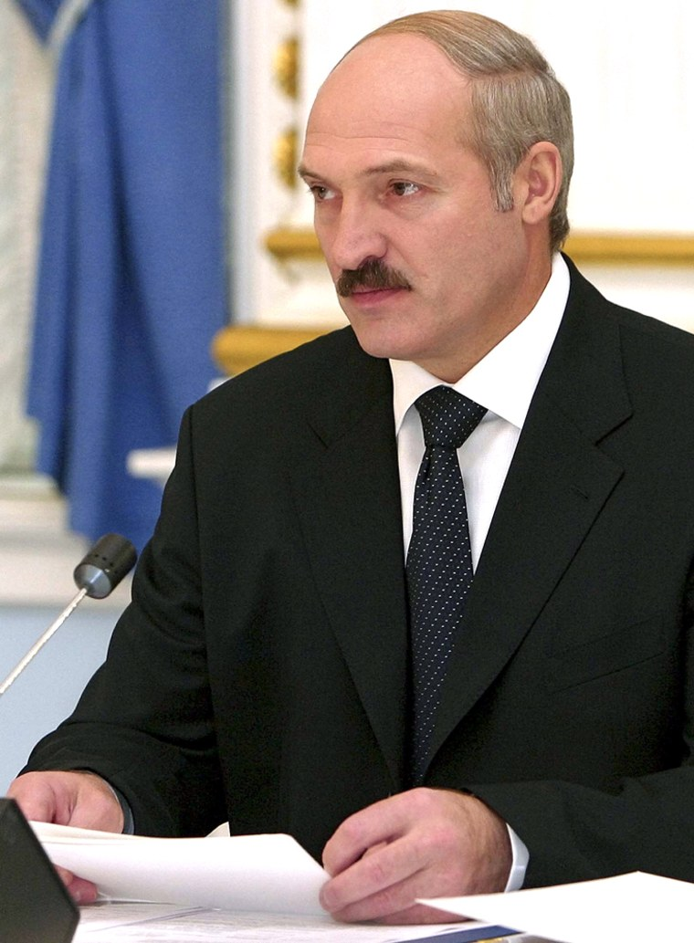 """Belarus President Alexander Lukashenko, at a news conference in Minsk, Monday. Lukashenko said he was """"pleased"""" with the results of the vote, which would allow him to run for a third term."""