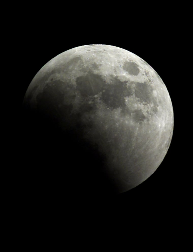 Moon begins to cross into Earth's dark shadow during total lunar eclipse
