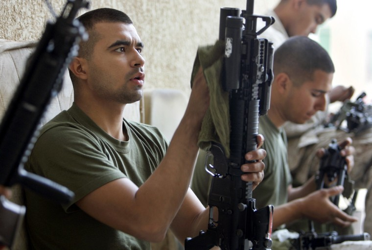 US Marines of the 1st Division clean their guns prior to a mission outside Fallujah on Monday.