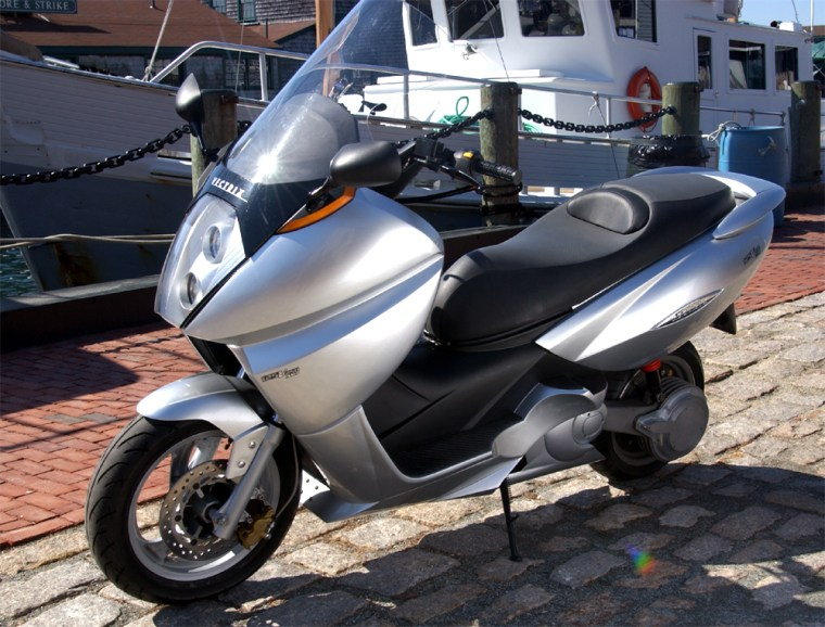 This prototype scooter by Vectrix Corp. runs on a fuel cell stack that gets a boost from a separate battery pack.