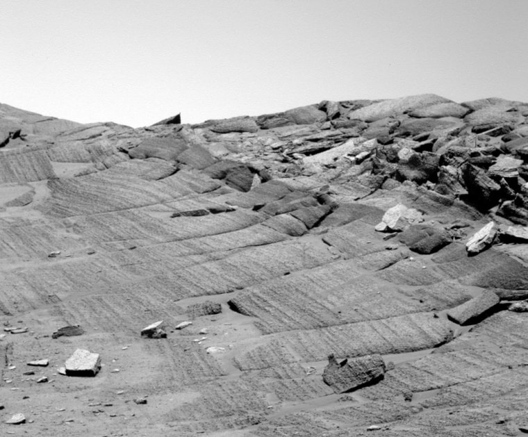 An image from NASA's Opportunity rover shows an intriguing stretch of layered rock on Mars. Geologists can analyze the pattern of layering for insights into the Red Planet's watery past.