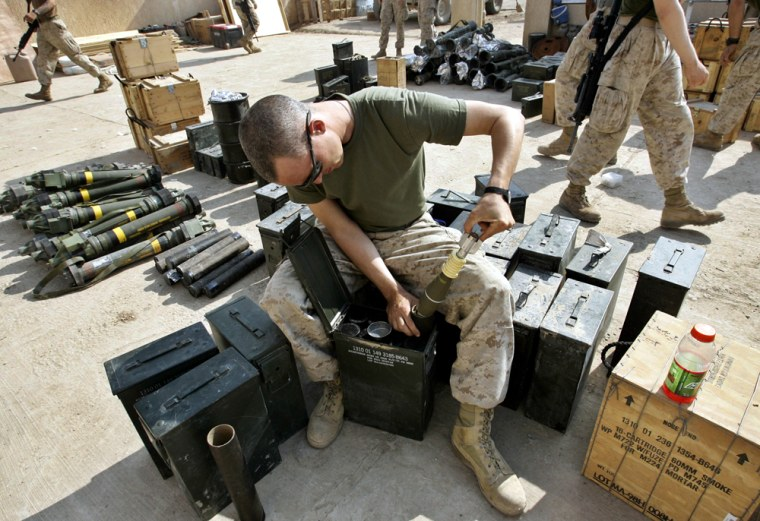 A U.S. Marine checks ammunition at a base outside Fallujah, Iraq, on Friday. Hoping to head off a major assault on theinsurgent stronghold, a group of Sunni clerics is proposing to negotiate a truce with insurgents in exchange for key political consecessions in the run up to January's election.