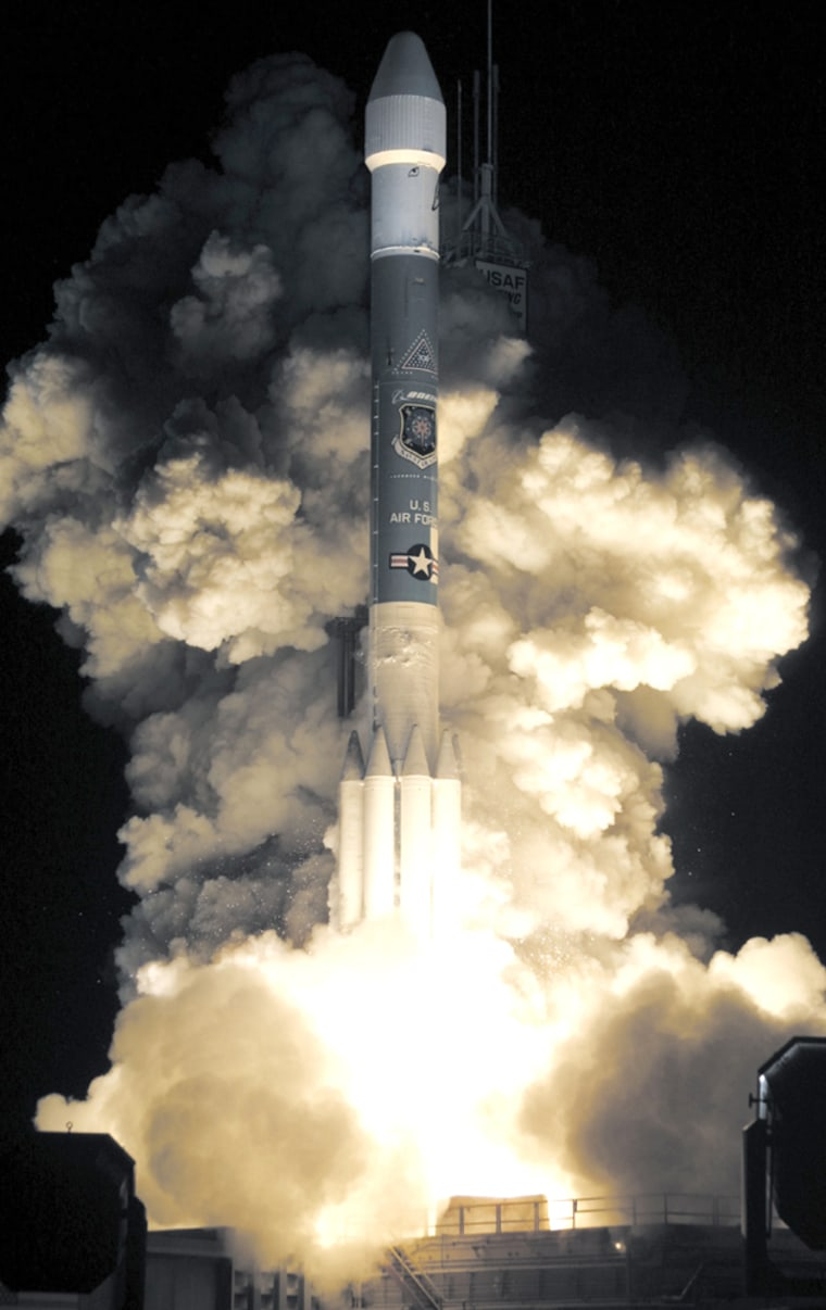 A Boeing Delta II rocket lifts off the launch pad from Cape Canaveral Air Force Station
