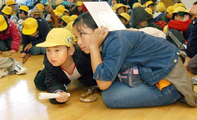 Japanese children crawl on floor as strong quake jolts Kawaguchi, northern Japan