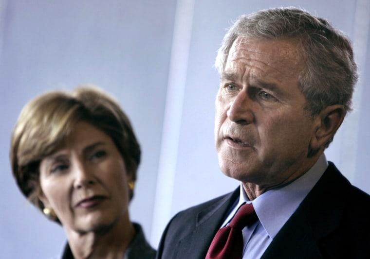 U.S President Bush speaks alongside first lady Laura Bush at an army hospital in Washington