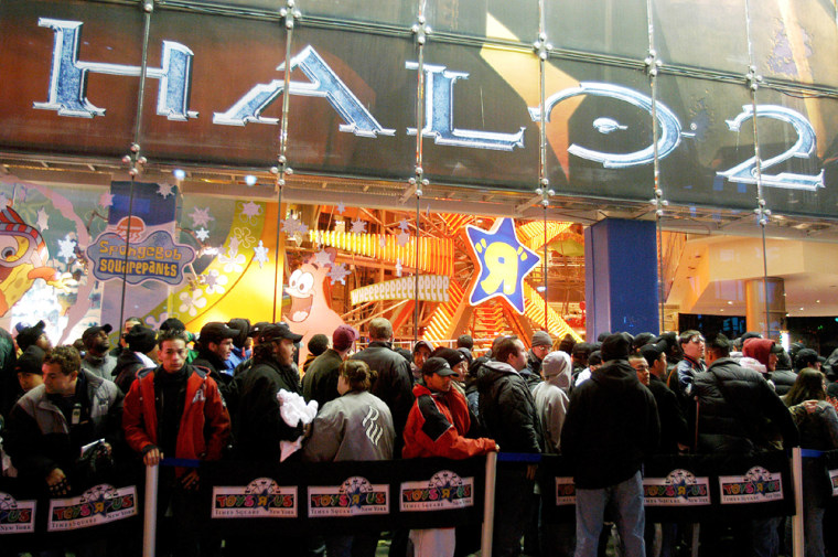 Gamers queue for the midnight release of video game Halo 2 in New York City