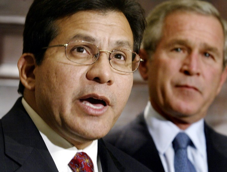 U.S President George W. Bush listens to his attorney general nominee Alberto Gonzales in Washington