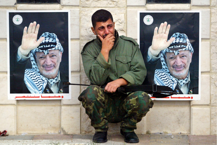 A member of Yasser Arafat's elite personal security unit, Force 17, weeps outside the Palestinian leader's former headquarters in Gaza City on Thursday morning after hearing of Arafat's death.