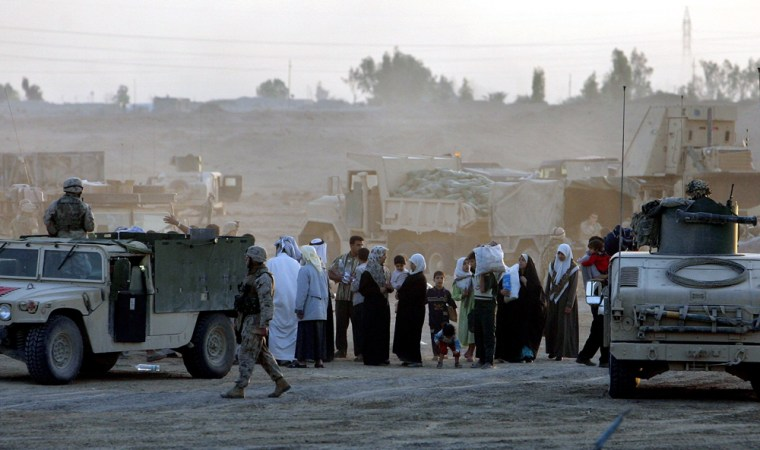 Refugees from Fallujah reach a US Marine checkpoint at the outskirts of the city onWednesday.
