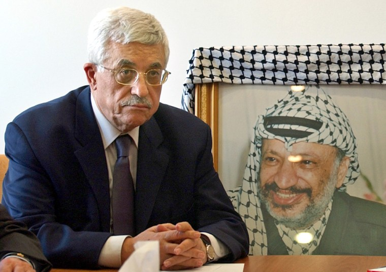 Ex-Prime Minister Mahmoud Abbas,seennext to aposter of the late Yasser Arafat, was named leader of the Palestinian Liberation Organization on Thursday.