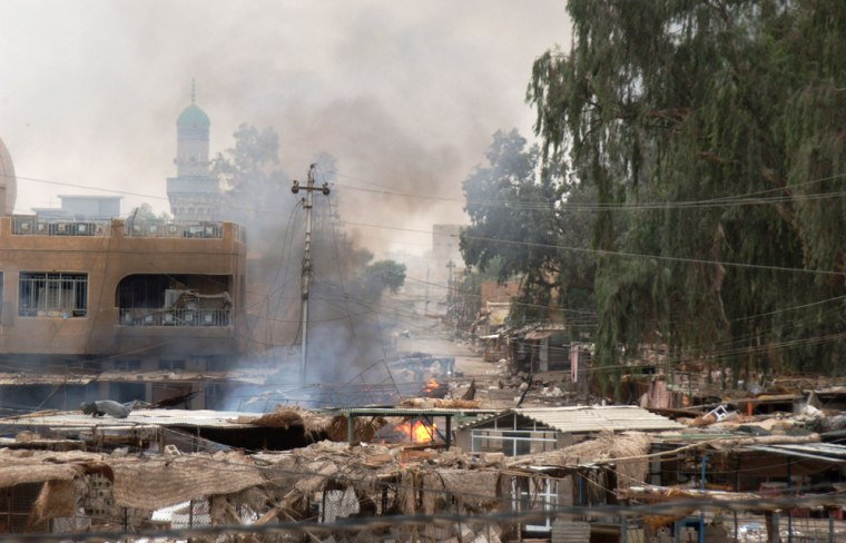 A U.S. Army photo shows buildings and debris burning in Fallujah on Tuesday.