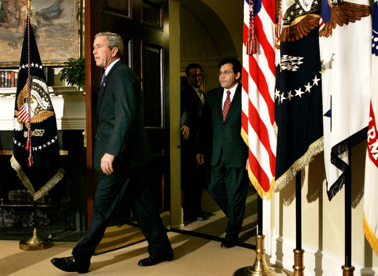 U.S President Bush walks into the Roosevelt Room along with attorney general nominee Alberto Gonzales