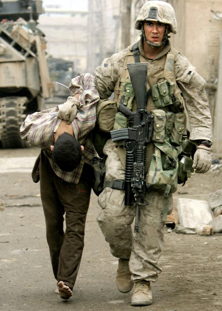 A U.S. Marine leads away a captured IraqiinFallujah on Friday.