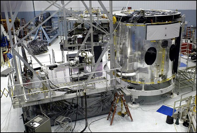 The robot test bed, left, is next to the Hubble high fidelity mechanical simulator. A mission to extend the telescope's life is revived because of 'dextre.'