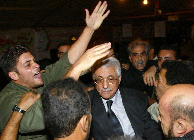 A Palestinian security guard shouts as h