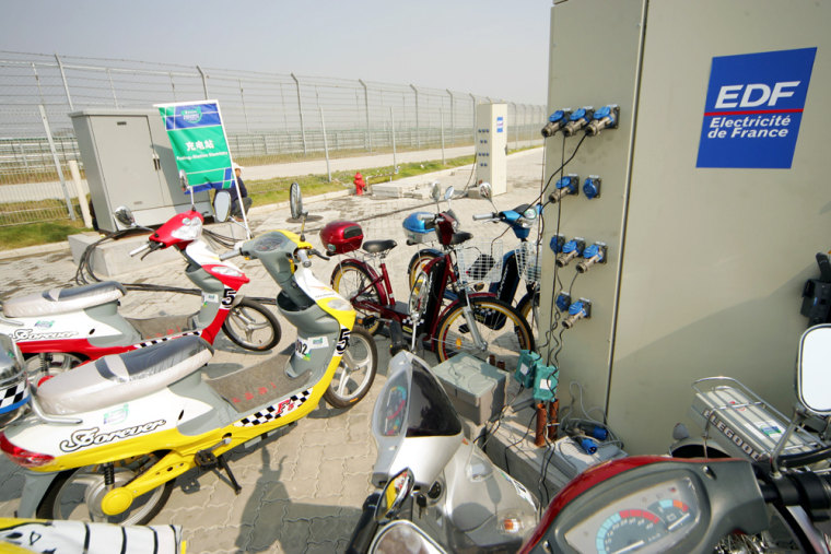 Chinese-made electric scooters and bikes get recharged at the 2004 Challenge Bibendum, a green vehicle rally for carmakers. The event was held in Shanghai last October. The recharging station was provided by EDF, France's electric utility company.
