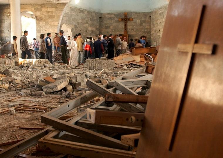Iraqis gather inside the damaged St. Matthew Church in Baghdad, Iraq, onNov. 9 following a car bomb attack.