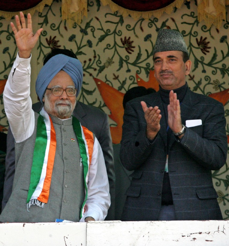 Indian Prime Minister Singh waves during public rally in Srinagar