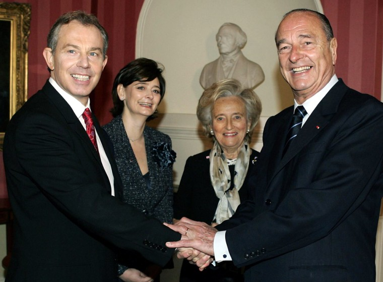 Prime Minister Tony Blair, left, shakes hands with President Jacques Chirac, right, as their wives, Cherie Blair, 2nd left, and Bernadette Chirac look on prior to their meeting Thursday.