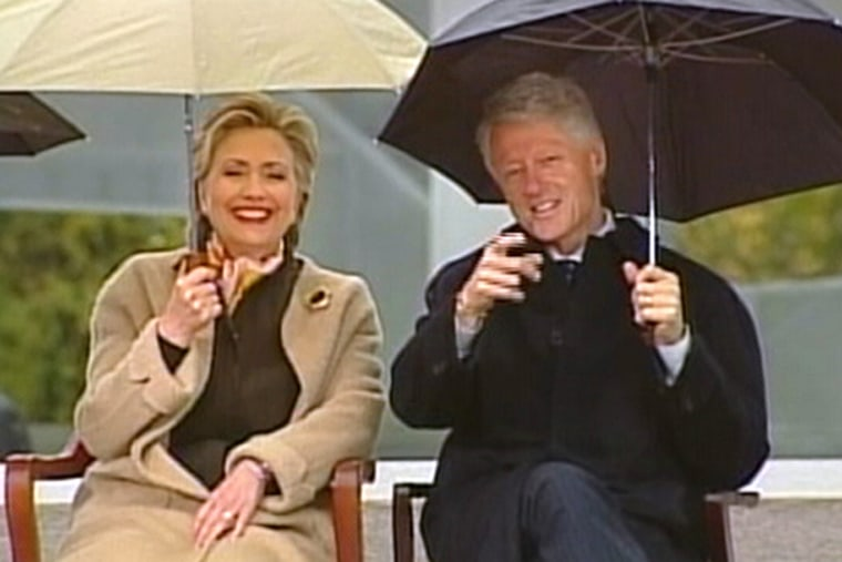 Former President Clinton and Sen. Hillary Clinton watch the crowd and procession of VIPs during Thursday's formal dedication of the Clinton Presidential Center.