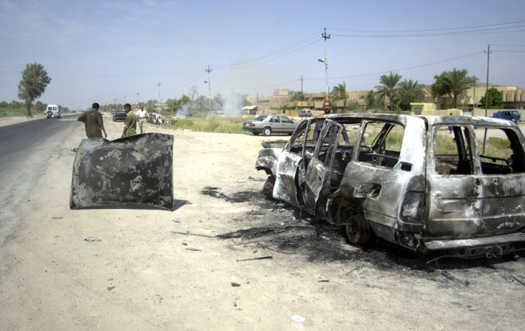 "The roads around Latifiyah, an Iraqi city in the region known as ""the triangle of death,"" are littered with burned and bullet-riddled wrecks."