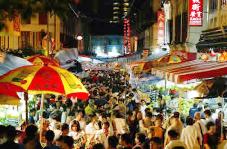 Thousands of well-wishers flood the streets of Singapore during a Lunar New Year celebration.