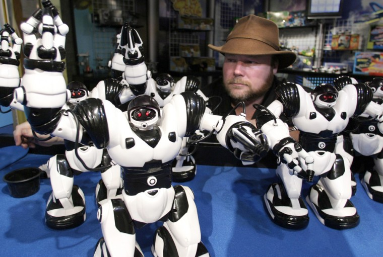 Robotics physicist Mark Tilden surveys a platoon of the Robosapien toys he designed for Hong Kong-based Wow Wee. Tilden, a specialist in biomorphic robotics,has worked for DARPA and NASA through Los Alamos National Laboratory.