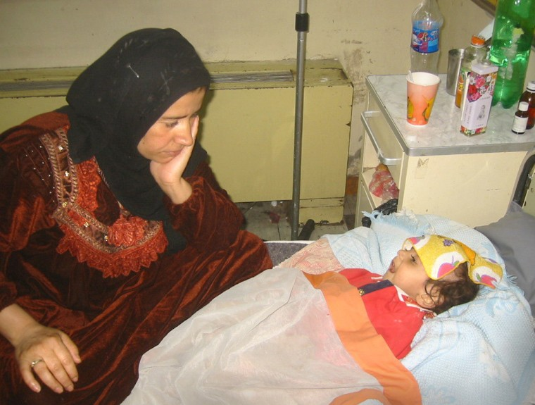 Suad Ahmed, left, watches over her 1-year-old son, Abdullah, at Baghdad's main children's hospital.Abdullah weighs just 11 pounds.