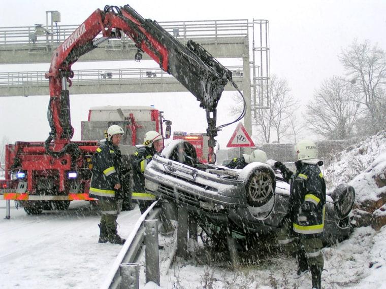 FIREBRIGADE OVERTURNED CAR