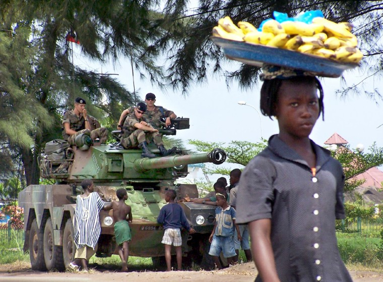 French soldiers talks with young local residents near Abidjan airport