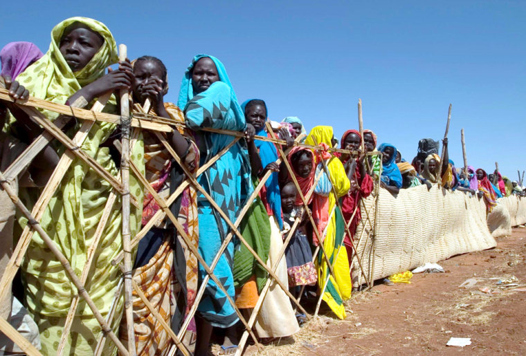 Displaced Sudanese women wait for food to be distributed on Nov. 9, in el-Sereif refugee camp, on the outskirts of Nyala town, in Sudan's western Darfur region.