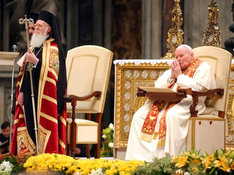 Pope John Paul II and Ecumenical Patriarch Bartholomew I, spiritual leader of the world's Orthodox Christians, pray inside St. Peter's Basilica, at the Vatican, onSaturday.