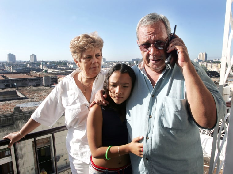 Cuban dissident poet and journalist reunited with his family after being released from jail