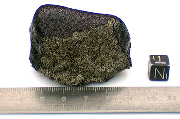This moon rock, designated LAP 03632,was found almost a year ago in Antarctica. A ruler marked in centimeters is included for scale.