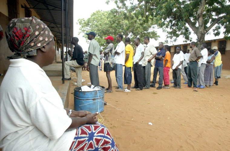 Voterswait in line to cast their ballotsfor president Wednesday in Polana, just outside Maputo, Mozambique.