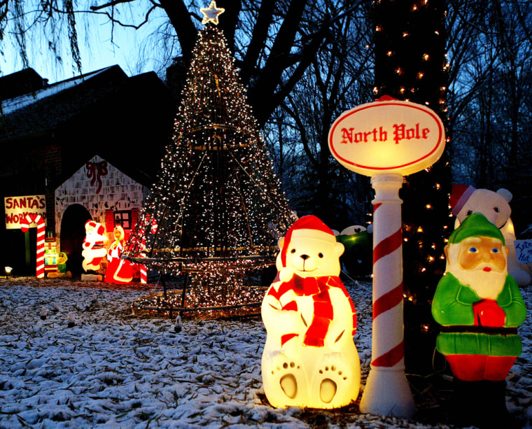 Holiday decorations and high-tech, computer-coordinated lights fill Greg Parcell's front yard in Geneva, Ill.