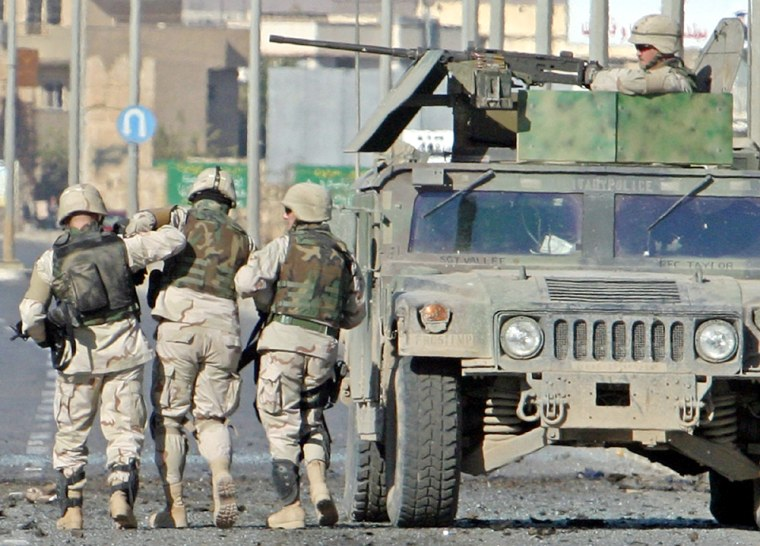 US soldiers guide wounded colleague at scene of attack in Mosul